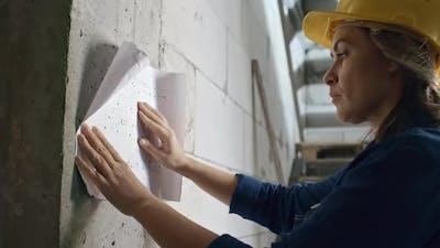 Engineer Inspecting Floor Plan