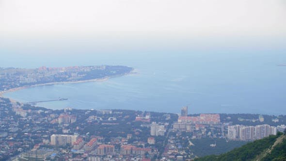 Thumbnail for Gelendzhik City Panorama on Sea Coast From Above. Seaside Resort City Panning View. Orthodox Cross
