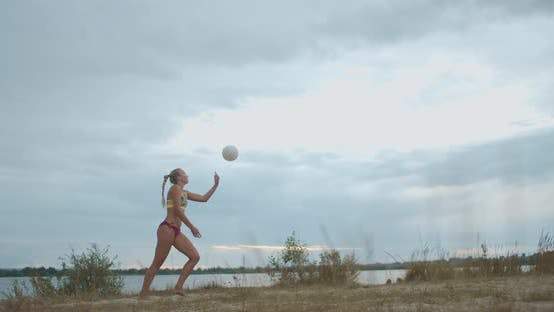 Training of Beach Volleyball Team on Open Sandy Court, Female Player Is Serving Ball, Ladies Sport