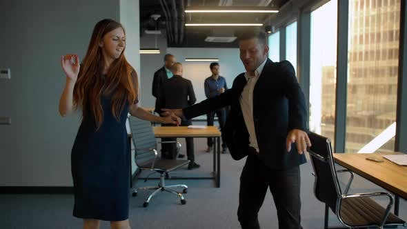 Thumbnail for Couple in Business Office Dancing After Winning Deal Celebrating
