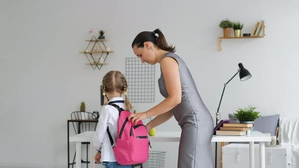Mother Helping Daughter Get Ready for School