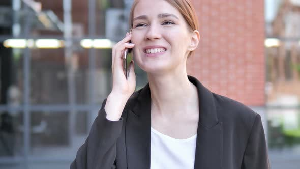 Cover Image for Young Businesswoman Talking on Phone Outdoor