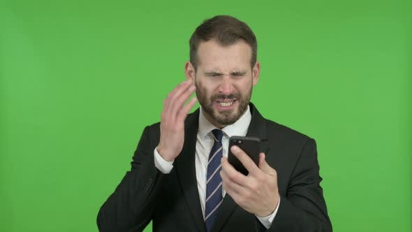 Thumbnail for Frustrated Young Businessman Get Angry on Call Against Chroma Key