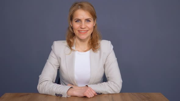 Thumbnail for Mature Businesswoman Sitting in Office