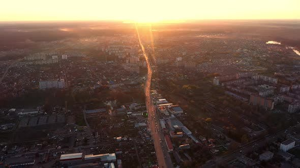 Sunset Over City Streets Aerial View