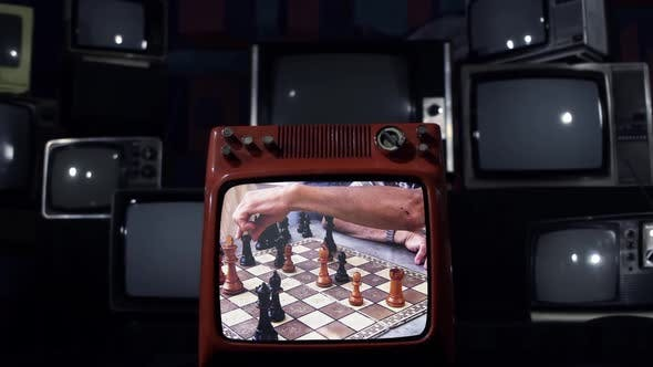 Thumbnail for Retro TV with a Chess Game Getting Shot.
