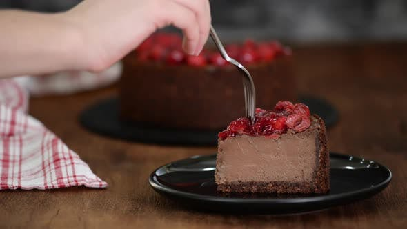Thumbnail for Eating piece of chocolate cheesecake.