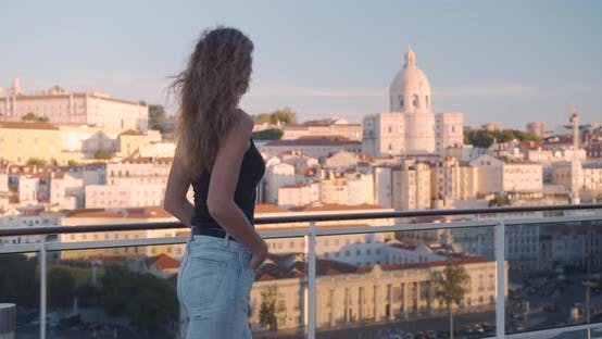 Thumbnail for Happy Woman Walking on the Balcony with View on the City Lisbon, Portugal.