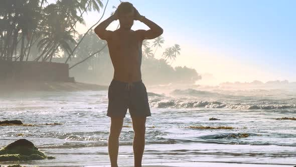 Thumbnail for Sporty Man in Shorts Silhouette Massages Head in Morning
