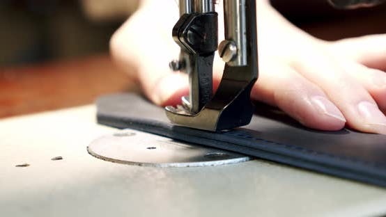 Professional sewing machine in action, leather sewing needle