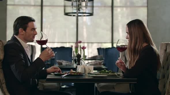 Thumbnail for Man and Woman Tasting Red Wine at Restaurant Dinner. Couple Dining in Restaurant