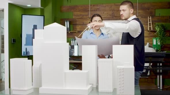 Thumbnail for Chief Architect Talking with His Team About New Business Park