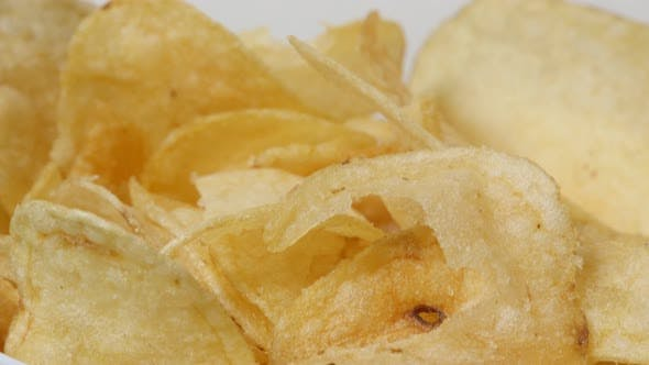 Thumbnail for Salted potato chips sliced and fried in a bowl popular  appetizer 4K 3840X2160 UltraHD footage - Veg