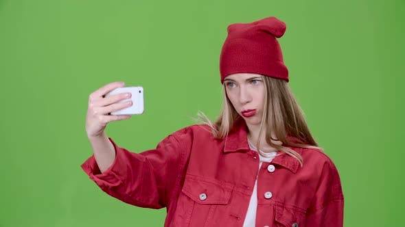Thumbnail for Teenager Makes Selfie with Different Emotions. Green Screen