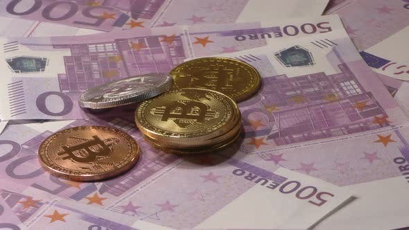 Thumbnail for Bit Coin BTC Coins Rotating on Bills of 500 Euro Banknotes. Worldwide Virtual Internet