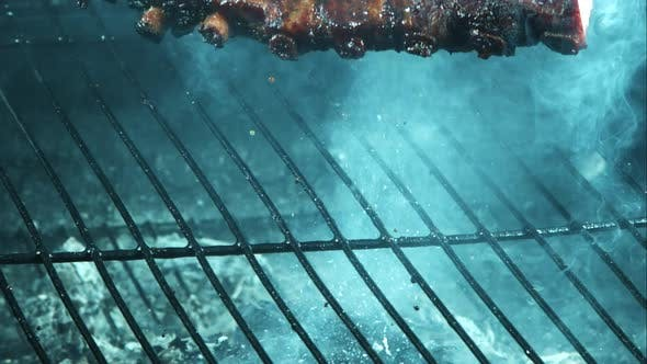 Grilling BBQ Ribs in ultra slow motion 1500fps on a Wood Smoked Grill - BBQ PHANTOM
