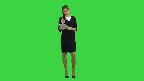 Thumbnail for Pretty Business Woman Giving Presentation Using Digital Tablet on a Green Screen, Chroma Key