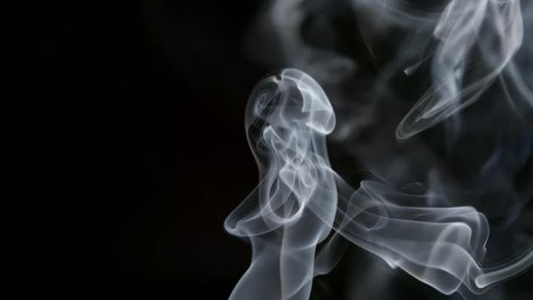Thumbnail for Curve Smoke Lifts Up On A Dark Background