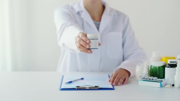 Thumbnail for Doctor with Medicine and Clipboard at Hospital