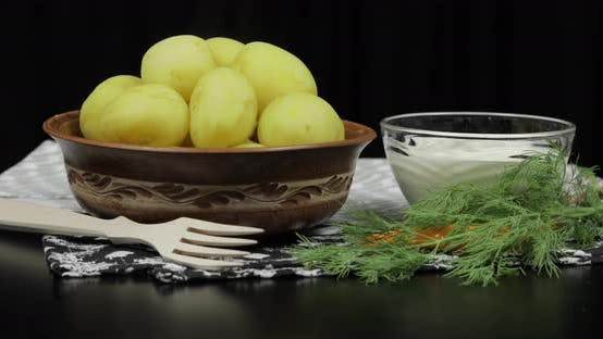 Thumbnail for Boiled New Delicious Potato on Plate on Table Ready To Eat. Dill, Sour Cream