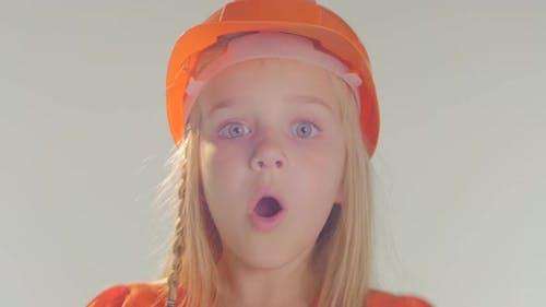 Girl playing peek boo