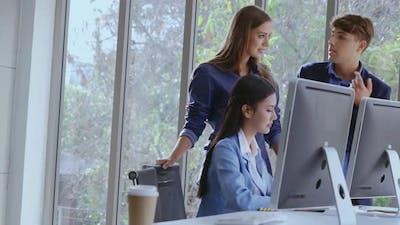 Businesswoman and Businessman Having Conversation in Modern Office