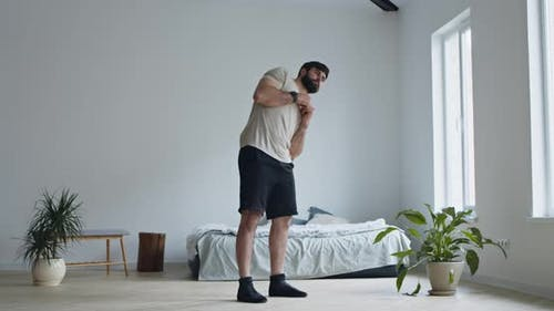 Young Man Working Out at Home Interior