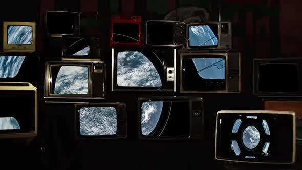 Thumbnail for Earth seen from International Space Station Window On Stacked Retro TVs.