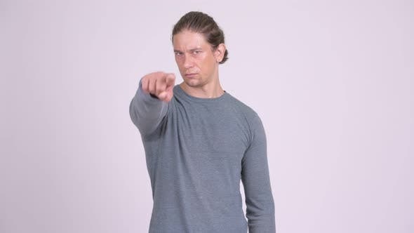 Thumbnail for Handsome Man Pointing To Camera Against White Background