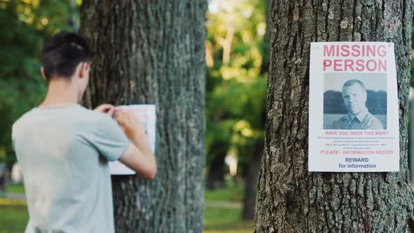 Thumbnail for A Young Man Puts Up Ads for a Missing Person in the Park