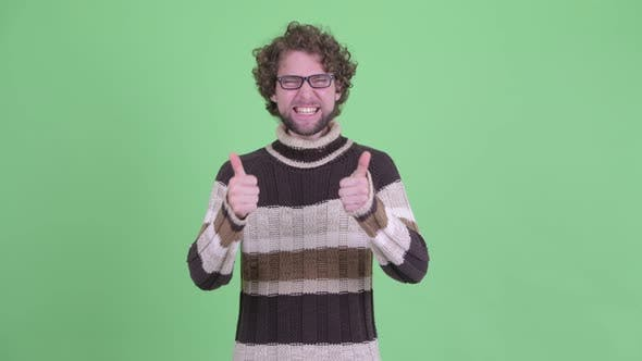 Thumbnail for Happy Young Bearded Man Giving Thumbs Up and Looking Excited