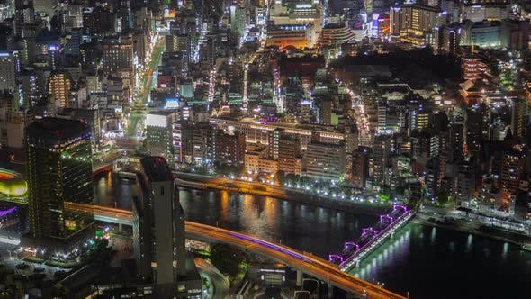 Thumbnail for Timelapse Overpass Roads and Boats on River Reflecting Tokyo
