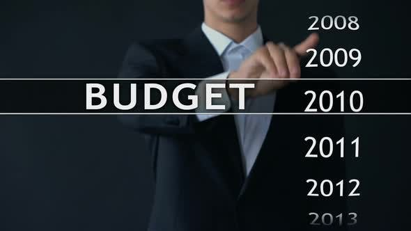 Thumbnail for 2015 Budget, Businessman Selects File on Virtual Screen, Annual Financial Report