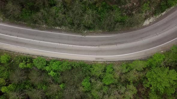 Thumbnail for Directly Above View of Winding Mountain Road with Cars