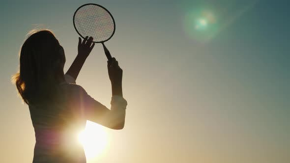 Cover Image for A Woman Strikes a Racquet on a Ruffle