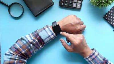 Man's Hand Using Smart Watch