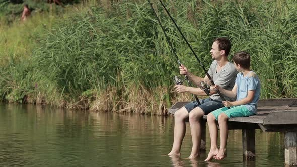 Thumbnail for Family Fishing with Rods By the Pond in Summer