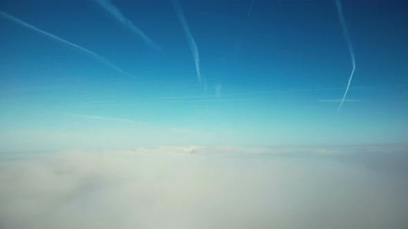 Thumbnail for Flying and Rising Above Clouds Towards Sunny Horizon and Clear Blue Sky