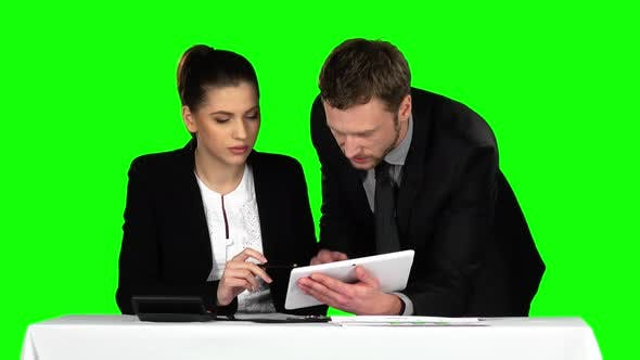 Cover Image for Business Man and Woman Using Laptop in Office Lobby, Green Screen
