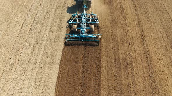 Thumbnail for Tractor with Disc Harrows on the Farmland