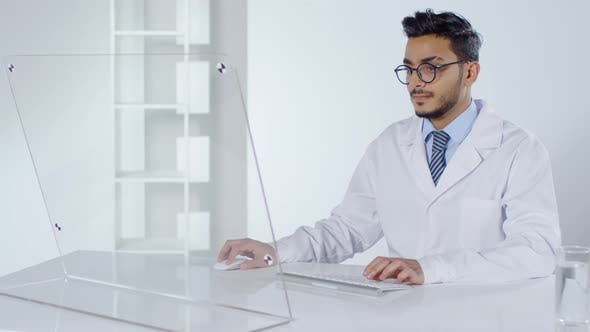 Thumbnail for Doctor Working on PC with Transparent Display
