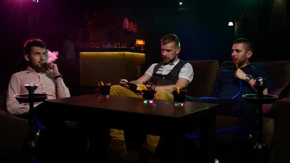 Thumbnail for Boys Smoking Hookah in the Caffee. Slow Motion