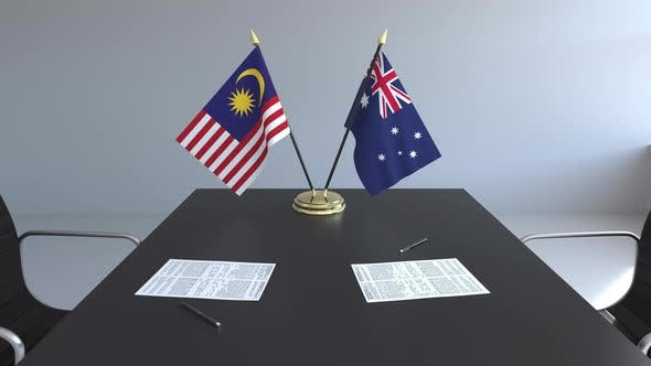 Flags of Malaysia and Australia on the Table