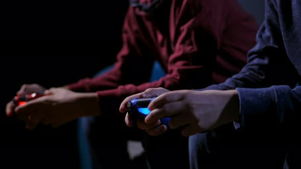 Hands of Teen Boys Playing Video Game