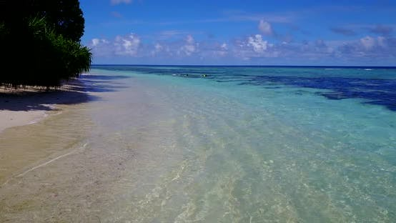 Thumbnail for Wide angle above island view of a white sand paradise beach and turquoise sea background in 4K