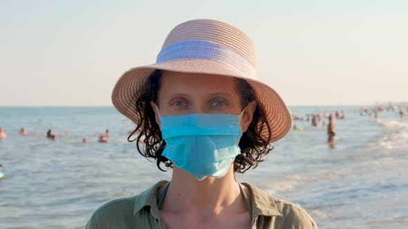 Thumbnail for Woman in disposable mask looking at the camera. Vacation and coronavirus outbreak.