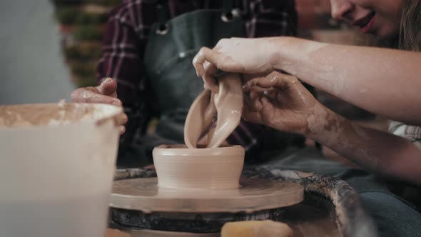 Potter Masterclass Man and Woman are Working with Pottery Wheel Making Pots During Master Class for