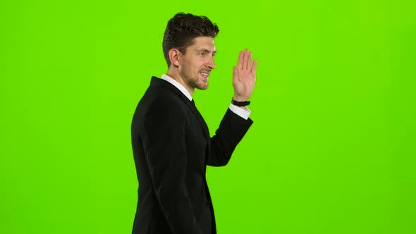 Thumbnail for Businessman Is Going To a Meeting and Waving Greetings. Green Screen. Side View