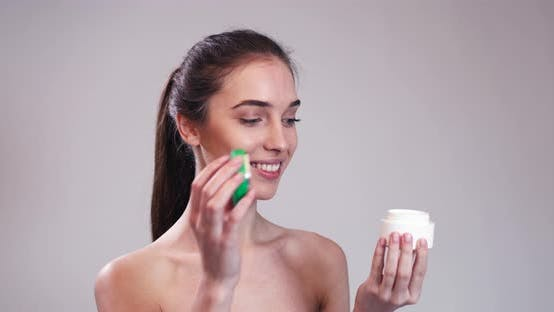 Thumbnail for Beautiful Girl Holding and Smelling Cream Jar