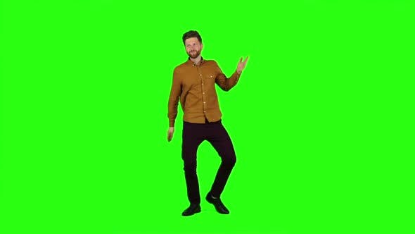 Thumbnail for Guy Is Dancing Energetically, He Is Having Fun. Green Screen. Slow Motion